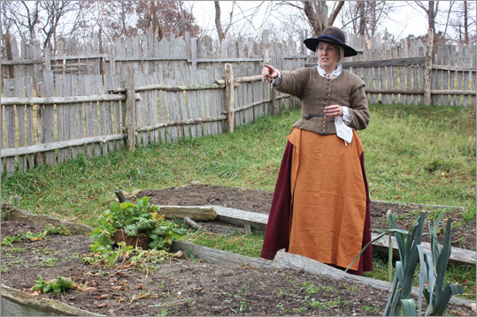 A colonist showed off her garden. Asking questions and discussing 1627 life in the village is an integral part of the learning experience at the museum.