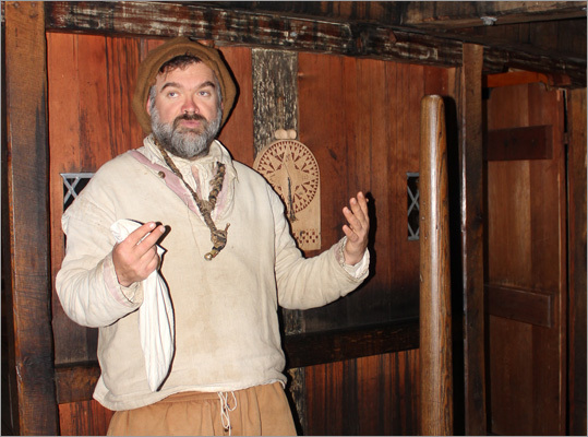 A colonist role player displayed how one might have steered the Mayflower from below deck.