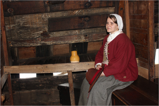 A role player played a colonist passenger, and answered questions about her journey from visitors aboard the ship.