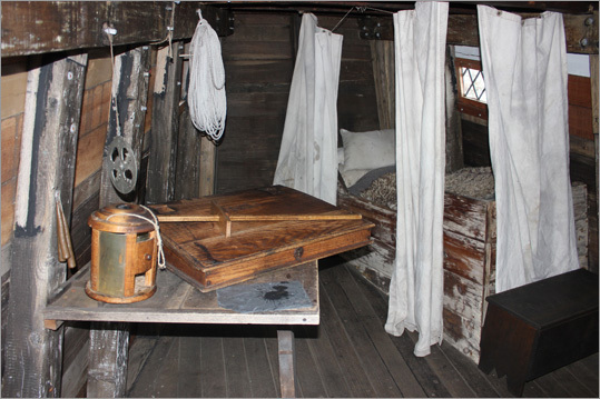 At left, what a typical sleeping quarters might have looked like on the original Mayflower.
