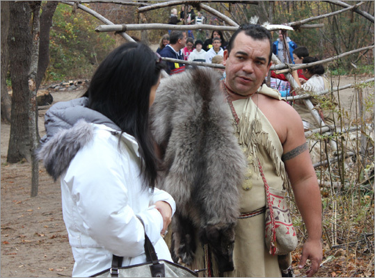 Local Wampanoags, dressed in traditional attire, engage with visitors to provide a modern point of view of their history.