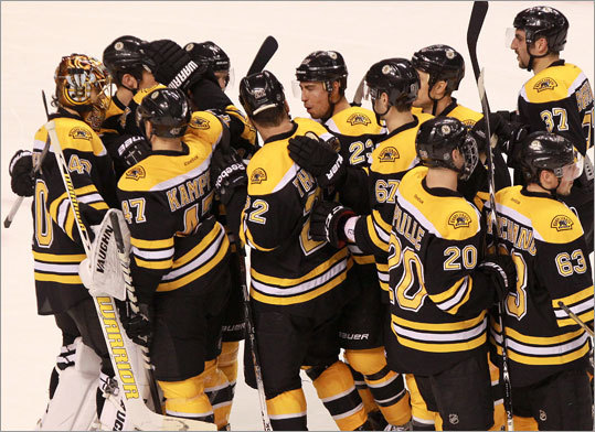 Bruins goalie Tuukka Rask celebrated with teammates after defeating the Blue Jackets, 2-1. The Bruins won their seventh straight game.