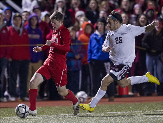 Div. 1 boys' soccer Stephen Pease (left) and Masconomet came up short agains Kyle Tomas and Ludlow in the MIAA Division 1 final at Worcester State University. Tomas scored two second-half goals to lead Ludlow to a 2-1.