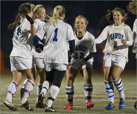 Div. 1 girls' soccer Peabody's Katie Brunelle (1) celebrated her first-period goal with teammates Bianca Muscato (22) and Cayla Bucci (2). Brunelle's goal gave Peabody a 1-0 victory over East Longmeadow in the Div. 1 state final played at Worcester State University.