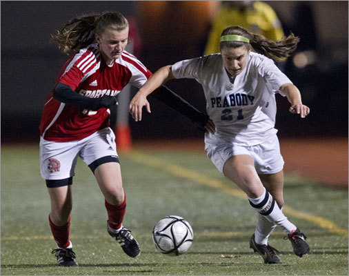 Div. 1 girls' soccer Peabody's Haley Dowd raced East Longmeadow High's Danielle White for control in the first half of the final.