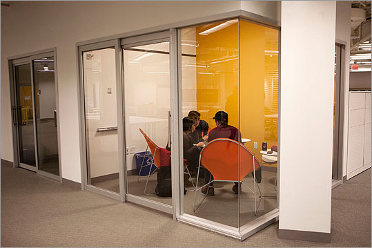 Harvard business school students worked together in a 'fishbowl conference room'.