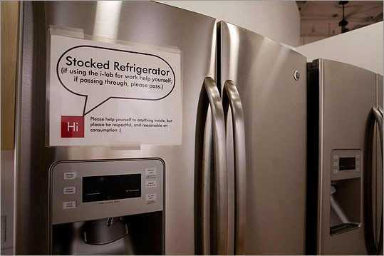 The refrigerator in the community kitchen of the new Harvard innovation lab is stocked with food for working students to eat.