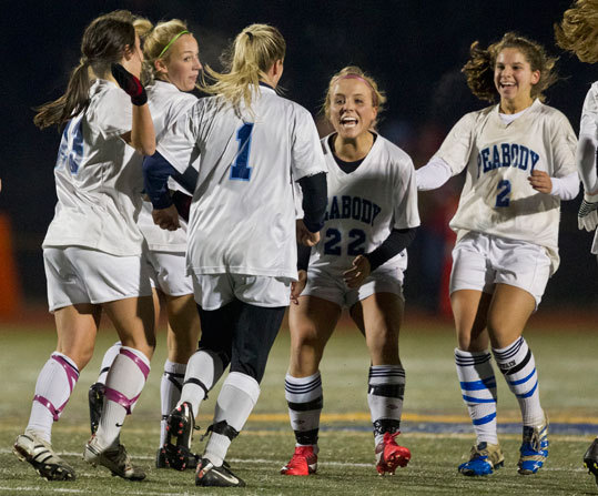 Peabody High's Kaatie Brunelle (1) celebrated her goal with teammates Bianca Muscato (22) and Cayla Bucci (2) during the first half against East Longmeadow. Peabody beat East Longmeadow 1-0 in the girls Div. 1 state final.