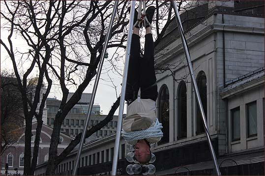 Entertainer Jason Escape, was among the performers at Faneuil Hall. He got into the holiday spirit Houdini-style: He suspended himself in midair while wearing a straightjacket, bound by rope -- all while cracking jokes -- then freed himself.