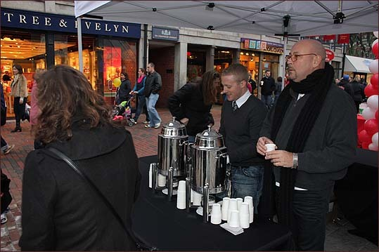 Jeff Watson (left) and Michael Murphy represented the Ames Hotel in Boston, and served free cups of hot cider for passersby, to spread holiday cheer, as Murphy put it.