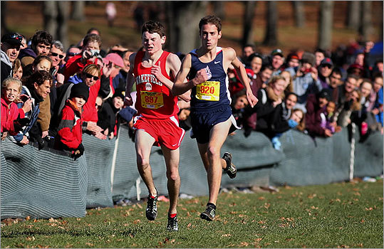 Div. 2 boys' cross country Wakefields's Stephen Robertson (left) was passed by Wesley Gallagher (right) of Pembroke as they closed in on finish line. Gallagher edged Robertson for the individual title by one second. State cross country championships results