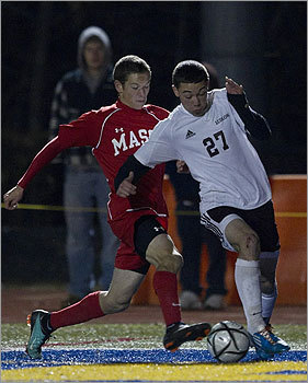 Div. 1 boys' soccer Masconoment High's Wes Shrewsbury tried to knock the ball away from Ludlow High's Shaun Mello during second half action.