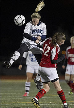 Div. 1 girls' soccer Peabody High's Kaatie Brunelle pushed the ball forward behind East Longmeadow High's Danielie White.