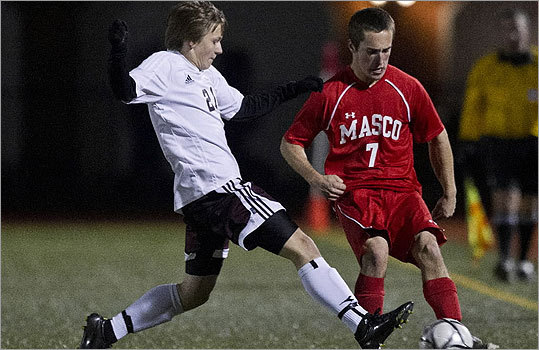 Div. 1 boys' soccer Masconoment High's Charlie Behrens runs into defensive pressure from Ludlow High's Kieffer Kalsenik-Orsulak .