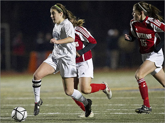 Div 1 girls' soccer Peabody High's Haley Dowd pushed the ball forward in front of East Longmeadow High's Amanda Ferrero.
