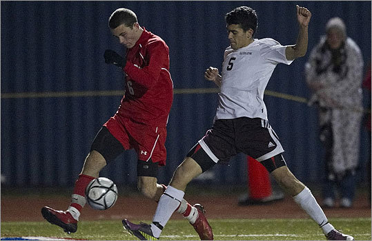 Div. 1 boys' soccer Masconoment High's Charles Sherman centered the ball with pressure form Ludlow High'sGreg Santos.