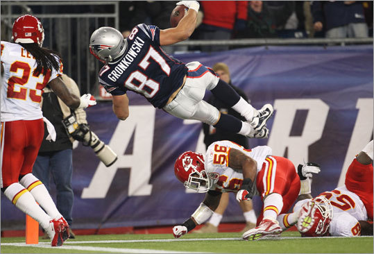 "Gronkowski appeared slighty shaken up on his touchdown play, and was checked by team medical personnel on the sideline. ""They were just asking me questions like they got to and if I was fine and everything,' said Gronkowski. 'I was fine. I just got the wind knocked out of me a little bit, so I mean you know how that is when it happens."""