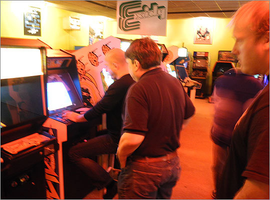 ACAM is open year-round, admission is free, and most of the games still cost one token, or 25 cents. Pictured, Missile Command world record holder Tony Temple of England (seated) drew a crowd as he showed his mastery of the classic game. Read the Boston.com article.