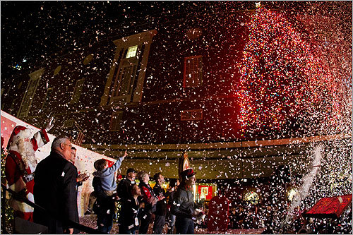 Mayor Thomas Menino, Santa Claus and hundreds of people gathered in front of Macy's Downtown Crossing to watch the store's Christmas tree lighting ceremony on Friday.