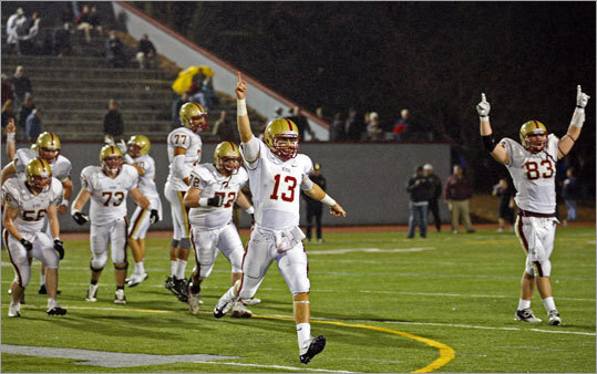 Boston College High quarterback Bartley Regan (13) leds his team off the field as they celebrated their victory over Chelmsford in the Division 1 semifinal. BC High advanced to the Div. 1 Super Bowl with a 34-13 victory. Click through the gallery to see more scenes from the 16 semifinals played at eight locations in Eastern Massachusetts on Tuesday.