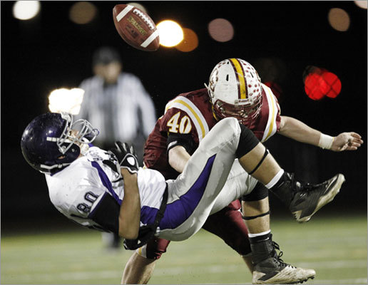 Cardinal Spellman linebacker Pat Hinkley jarred the ball loose from Shawsheen receiver Devin Summiel after a catch in their Div. 4 game.