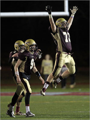 Tome Gregory jumped for joy after Concord-Carlisle defeated Holliston 32-27 in a Division 3 semifinal in Lowell.