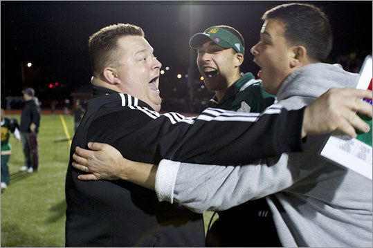 Cathedral coach Duane Sigsbury (left) celebrated with Garrett Nelson and John Cignetti after beating Chelsea 12-10 in the last seconds of their Division 4A semifinal at Reading High.