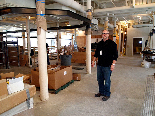 In this photo from Sept. 29, David Michael Lieb, construction manager for the renovation, stands inside the market area, about halfway down the south corridor between vendor stalls. Behind Lieb is the site of the future visitors' center desk.