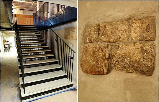 "In the basement, the new stair stands alongside an original granite foundation wall from the 1742 Faneuil Hall, prior to the building's expansion by Charles Bulfinch in 1806. Most of the granite has now been covered with a cementitious plaster to protect and stabilize the 269-year-old stonework, but three small sections were left for visitors to see how the foundation was constructed. ""You have to celebrate the historical nature of the wall,"" Lieb said."