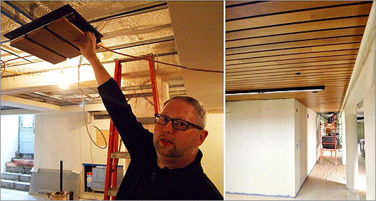 On the left, in September Lieb showed a sample section of the tongue-and-groove wooden slats that will cover the plaster and utility lines of the basement ceiling. By November, as seen on the right, much of the basement ceiling had been covered.