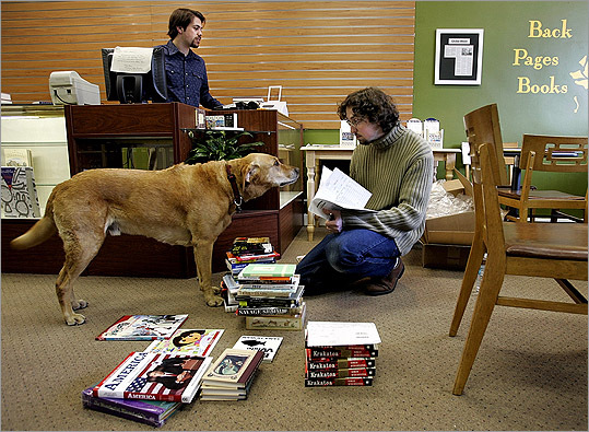 Back Pages Books Back Pages Books was opened in 2005 despite claims that independent bookstores were on the decline. The store has pushed for word-of-mouth marketing for its goods called 'The 1001 Book Project.' Owners Ezra Sternstein is pictured behind the counter, while owner Alex Green makes a new friend of the dog Ferdinand, who belongs to a browsing customer. The dog was named after the book 'Ferdinand the Bull.'