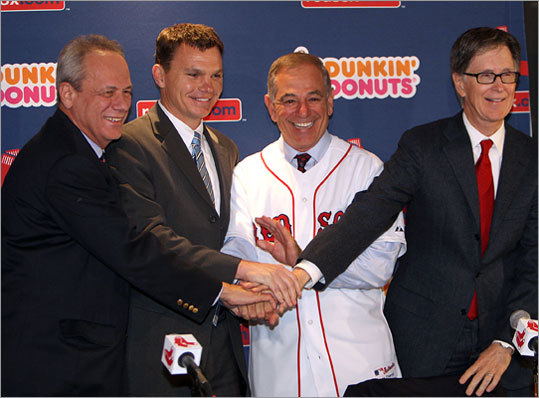 After Valentine answered reporters' questions, the Red Sox management team -- president Larry Lucchino, GM Ben Cherington, Valentine, and owner John Henry (from left) -- posed for a group shot.