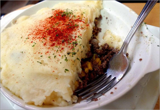 """La Binerie Mont-Royal - When the city's French-language newspaper Le Devoir did a survey a few years ago to determine Quebec's """"national'' dish, pâté Chinois (a version of shepherd's pie with layers of corn, ground beef, and mashed potatoes) was declared the winner. At La Binerie, a slight splurge lets you augment the dish with split pea soup and pouding chômeur (""""unemployed pudding'' of white cake baked with a maple-cream syrup) in a trifecta of old-fashioned Quebec cooking. This iconic eatery has been around since 1938 - back when the Plateau Mont-Royal was home to factory and mill workers. 367 avenue Mont-Royal est, 514-285-9078, www.labineriemontroyal.com , pâté Chinois $8.62, with soup, dessert, and coffee $10.54"""