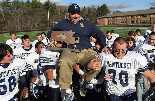 Division 5: Nantucket 35, Latin Academy 7 Nantucket's head coach Bill Manchester was carried offf the field by his players after Nantucket beat Latin Academy for the Division 5 title. It was Nantucket's first Super Bowl title since 1998.