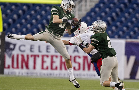 Division 2: Duxbury 35, Tewksbury 0 Duxbury High's defense was stingy all day. Left, James Burke leaped in front of Tewksbury receiver Kevin Saunders to intercept the ball during the first quarter.