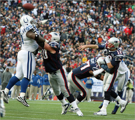 Guard Logan Mankins kept Colts defensive lineman Antonio Johnson (left) away from quarterback Tom Brady long enough to let Brady throw his first touchdown pass of the game in the second quarter, an 11-yard strike to Gronkowski.