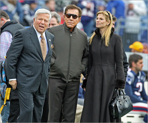 Gambling magnate Steve Wynn (center) and his wife, Andrea Hissom, were the guests of Patriots owner Robert Kraft. Wynn and Kraft have been discussing plans to build a casino near Gillette Stadium.