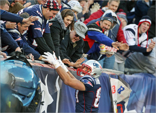 Tight end Rob Gronkowski scored three touchdowns to lead the Patriots to a 31-24 victory over the Indianapolis Colts. After one of his touchdowns, he celebrated with the fans at Gillette Stadium.