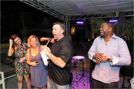 Former Red Sox Sean Casey and David Ortiz had some fun with attendees during the pairings party at the David Ortiz Celebrity Golf Classic at the Fishing Lodge Cap Cana in the Dominican Republic. Ortiz hosted his annual event to benefit the David Ortiz Children's Fund.