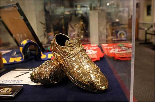Backers say a marathon museum would have to offer more than the Boston Athletic Association's collection of memorabilia, which includes running shoes worn by Bill Rodgers.
