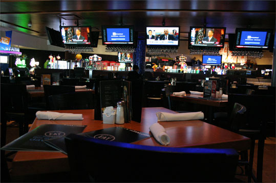 The new Dave & Busters has a much different feel than older ones, with lighter wood paneling, more TVs, and more open space. There are more than a dozen TVs in the bottom floor alone, with 16 at the bar, seven in the dining area, and two projectors in the game room.