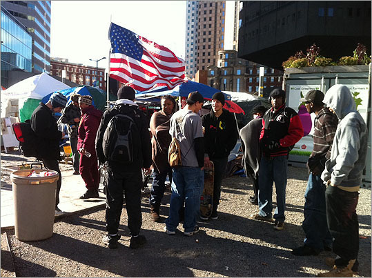 On Thursday morning, Dec. 8, Boston Mayor Thomas M. Menino gave Occupy Boston protesters a midnight deadline to leave their Dewey Square encampment. Take a look at the most recent Occupy Boston scenes.