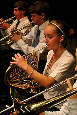 The model is inspired by how public education works, Cole said, and even though classes at the conservatory are not mandatory, the instructional map has people voluntarily coming back again and again. At left, Maggie Thompson plays the french horn with the Bay Youth Symphony