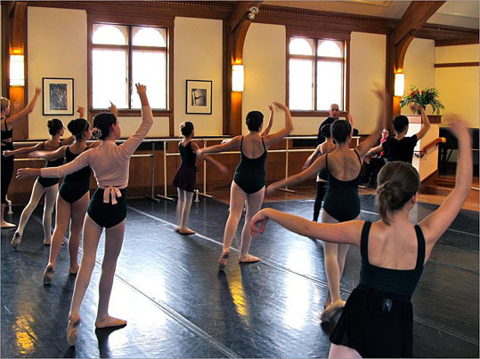 At left, a ballet class at the Conservatory's Duxbury campus where Jose Mateo Ballet Theatre instruction is given in the performance hall.