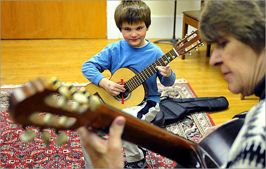 While many arts institutions are struggling in the weak economy, enrollment has grown to about 2,700 students at the South Shore Conservatory's campuses in Hingham and in Duxbury. The key is the organization's 'continuum' model that offers programs for students of all ages. Read the complete article here. Daniel Linnehan, 5, of Hingham, practices during his guitar lesson with Karen Rafferty.