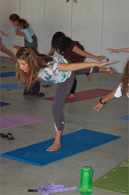 Implemented largely by Kathy Czerny, who became conservatory president in 2006, the model consists of interconnected clusters of programs geared to specific age groups. At left, a student holds a pose in a yoga class for teens.