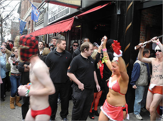 Just after 1 p.m., Speedo-clad runners poured out of the bar onto Boylston Street.
