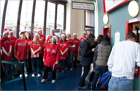 Season's Greetings from Fenway Park. The Red Sox hosted a ticket-buying event for lucky fans who were randomly selected in a lottery to attend the team's ninth annual Christmas party. The In Choro Novo choir sang as the first tickets of the season were gobbled up by fans.