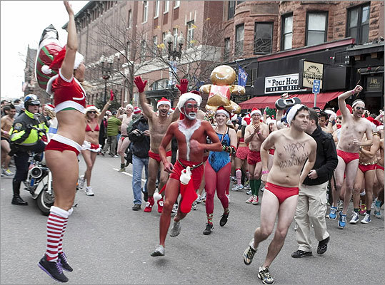Hundreds gathered in Boston for the 12th annual Santa Speedo Run on Saturday, Dec. 10. Runners, running enthusiasts, and fans of the quirky tradition took part in the roughly one-mile race down Boylston Street and Newbury Street. Proceeds benefit the Play Ball Foundation.