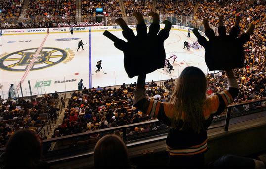 CAROLINE BRADY, 9, of Concord, at the Bruins-Red Wings game at TD Garden, Nov. 25, 2011 -- 'I go to a lot of Bruins games. I was cheering them on because their mascot is a bear. My aunt surprised me with these newBruins claws and I thought, 'Wow, maybe I can get on the big screen, 'cause I could actually look like a bear.' That was my goal. I was screaming, 'Go Bruins.' I was trying to get their attention. I was thinking that I love the Bruins and that it is really fun here. I thought the Red Wings were annoying. I think they would hate me because I was cheering for the Bruins. When I finally got on, it was like, 'Wow, there's my big face and I actually got on the big screen.' It was huge. My friends were like, 'Whoa, you actually did it.''